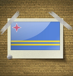 Flags Aruba at frame on a brick background vector image