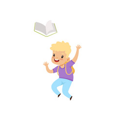 smiling little boy jumping with book elementary vector image