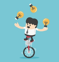 Businessman cycling juggling throwing a lamp vector image vector image