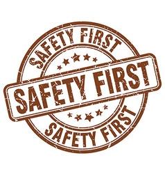 Safety first brown grunge round vintage rubber vector