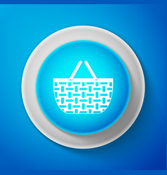 White wicker basket icon on blue background vector