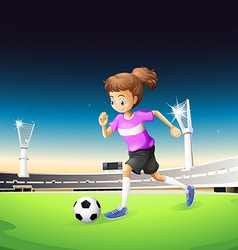 A girl playing football at the field vector image