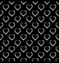 Seamless pattern of white hearts on black vector