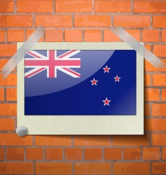 Flags New Zeland scotch taped to a red brick wall vector image