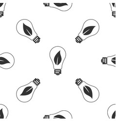 light bulb with leaf icon seamless pattern vector image