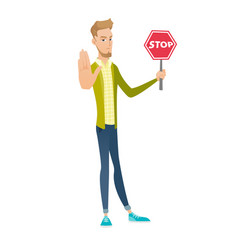 young caucasian businessman holding stop road sign vector image