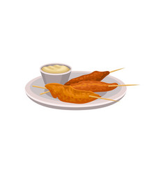 grilled chicken on wooden sticks and spicy dipping vector image