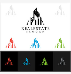 real estate logo design with home building vector image