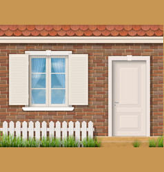 brick facade with a white window and a door vector image