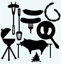 Grilled sausage on fork and on frying pan vector image