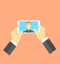 Businessman makes selfie vector image