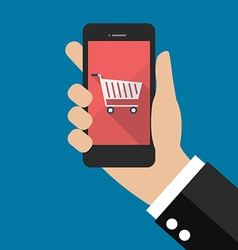Hand holding smartphone with cart icon vector
