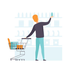 young man choosing products on shelves and pushing vector image