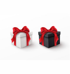 white and black gift box with red silk bow vector image