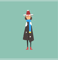 Young woman in warm coat scarf and hat freezing vector