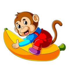 Cartoon monkey riding big banana vector