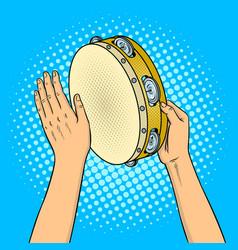 Hands with tambourine pop art vector