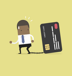 businessman with foot chained to bank credit card vector image