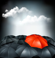 One red umbrella in a group of grey umbrellas vector image