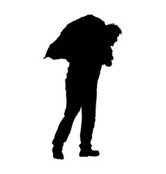 A man worker carries sack on shoulder silhouette vector