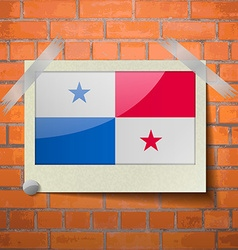 Flags Panama scotch taped to a red brick wall vector image
