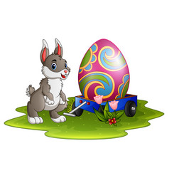 cute easter bunny with large eggs painted on a car vector image