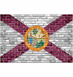 flag of florida on a brick wall vector image