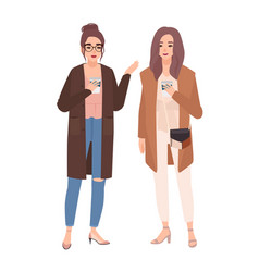 pair of two young pretty smiling women standing vector image