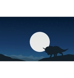 Silhouette of triceratops with moon landscape vector image vector image