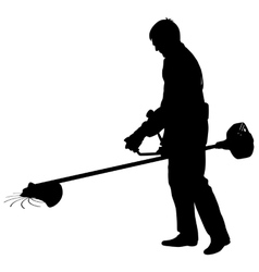 Silhouette worker of a garden cuts off grass vector image