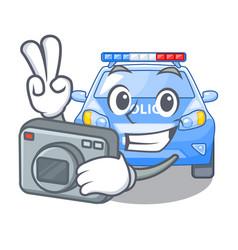 photographer miniature cartoon police car on table vector image