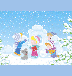 Small children building a snow fortress vector