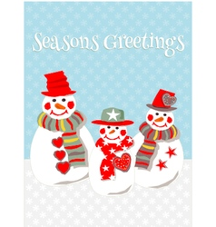 Three smiling snowmen in the snow vector image