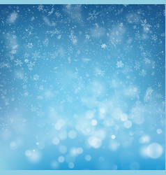 Blurred bokeh light snowflakes on blue background vector
