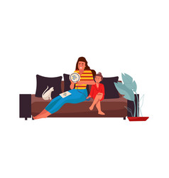 Mother and daughter with cat on sofa cross stitch vector