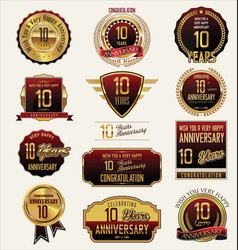 Anniversary golden labels and badges 10 years vector