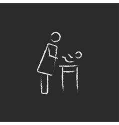 Mother taking care of the baby icon drawn in chalk vector