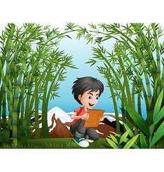 A boy holding a frame at the rainforest vector image vector image