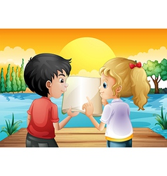 Two teenagers reading an empty book at the wooden vector image