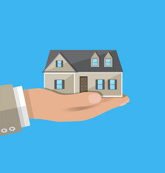 Businessman hand holding house real estate vector