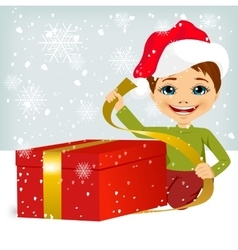 Cute little boy wrapping present vector