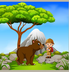 adventurer and bear posing with mountain scene vector image