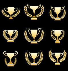 Golden winner awards with wreaths vector