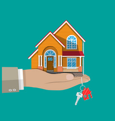 Hand with small house and keys vector