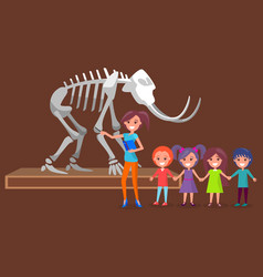 schoolkids with teacher in museum with skeleton vector image