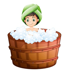 A cute little girl taking a bath vector image