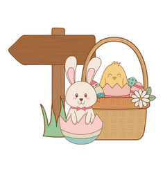 little rabbit and chick with egg painted in basket vector image