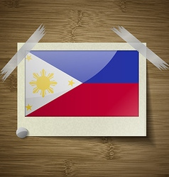 Flags Philippiines at frame on wooden texture vector