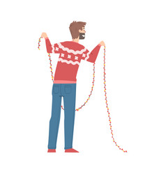 man in christmas sweater holding garland back vector image