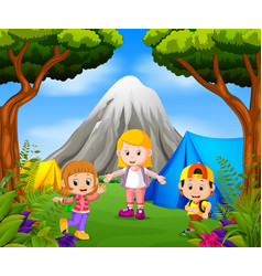 children camping out in the park with mountain vector image
